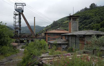 This photo taken on June 18, 2012, shows the abandoned mine of Figaredo, in Turon, near Oviedo. Spanish coal miners are staging nationwide protests actions organized by Unions against the cash-strapped government's decision to slash subsidies to the sector this year to 111 million euros ($142 million) from 301 million euros last year. Unions argue the subsidy cuts will lead to the closure of Spain's coal mines and the loss of up to 30,000 direct and indirect jobs, since Spanish coal relies on state aid to compete with cheaper imports. AFP PHOTO / MIGUEL RIOPA